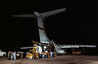A C-141 unloading before dawn at Ellington Air Force Base, Houston.