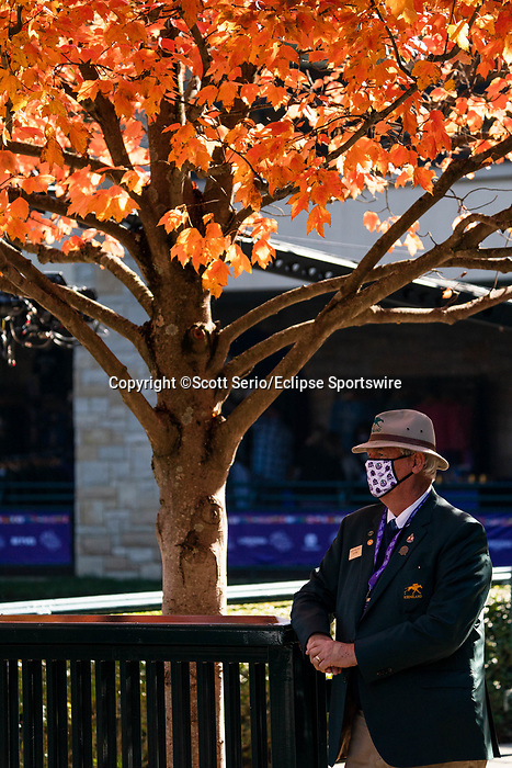 November 7, 2020 : An attendee stands under fall foliage on Breeders' Cup Championship Saturday at Keeneland Race Course in Lexington, Kentucky on November 7, 2020. Scott Serio/Eclipse Sportswire/Breeders' Cup/CSM
