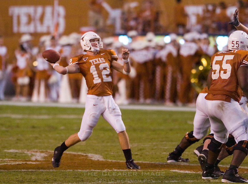 30 September 2006: Texas quarterback Colt McCoy (#12) unleashes a long touchdown pass to Limas Sweed (not pictured) during the Longhorns 56-3 victory over the Sam Houston State Bearkats at Darrell K Royal Memorial Stadium in Austin, TX.