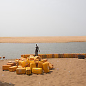 Togo - Outskirts of Aneho - Tanks ffilled with petrol are lined along the ocean. As fishing has become less remunerative due to the effects of climate change on the fish stocks, several local fishermen have retorted to fuel smuggling, a highly lucrative but illegal practice which consists in trafficking jerrycans of petrol from Nigeria through Benin and Togo by sea.