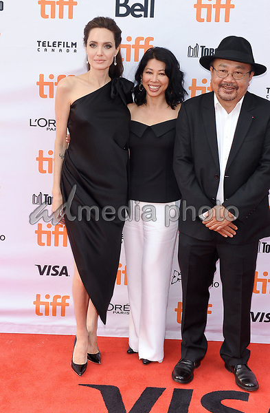 """11 September 2017 - Toronto, Ontario Canada - Loung Ung, Angelina Jolie, Rithy Panh. 2017 Toronto International Film Festival - """"First They Killed My Father"""" Premiere held at Princess of Wales Theatre. Photo Credit: Brent Perniac/AdMedia"""