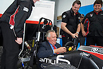 Peter Hain MP, the Secetary of State for Wales with students at the launch of Swansea Metropolitan University's new BSc (Hons) degree in Motorsport Technology at the Pembrey Motor Circuit in Llanelli today. Mr Hain took to the wheel of one the University's fleet of motorsport vehicles and drove a couple of laps at high speed around the circuit..