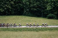 yellow jersey / GC leader Geraint Thomas (GBR/SKY) & team + peloton up the first climb of the day: the Montée de Bisanne<br /> <br /> Stage 6: Frontenex > La Rosière Espace San Bernardo (110km)<br /> 70th Critérium du Dauphiné 2018 (2.UWT)