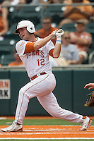 Texas Longhorns designated hitter Jacob Felts #12 follows through on his swing during the NCAA baseball game against the Oklahoma State Cowboys on April 26, 2014 at UFCU Disch–Falk Field in Austin, Texas. The Cowboys defeated the Longhorns 2-1. (Andrew Woolley/Four Seam Images)