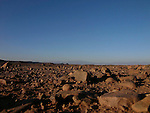 A view from near Quarzazate across the stoney flatland and semi desert towards the High Atlas Mountains in Morocco.