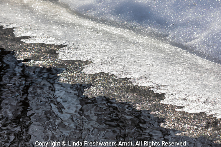 Melting snow and ice causing an ice shelf in northern Wisconsin.