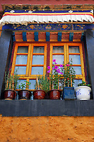 Detail of window, painted in traditional Tibetan style, in the courtyard of Ani Sanghkhung Nunnery,  Lhasa, Tibet, China.