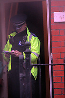 Pictured: A police officer at the house of Joshua Davies in Aberkenfig south Wales. Tuesday 26 October 2010<br /> Re: South Wales Police are investigating the murder of fifteen year old Rebecca Aylward from Maesteg, whose body was discovered in woods in Aberkenfig near Bridgend south Wales. Two fifteen year old men have been arrested and are being questioned by police.