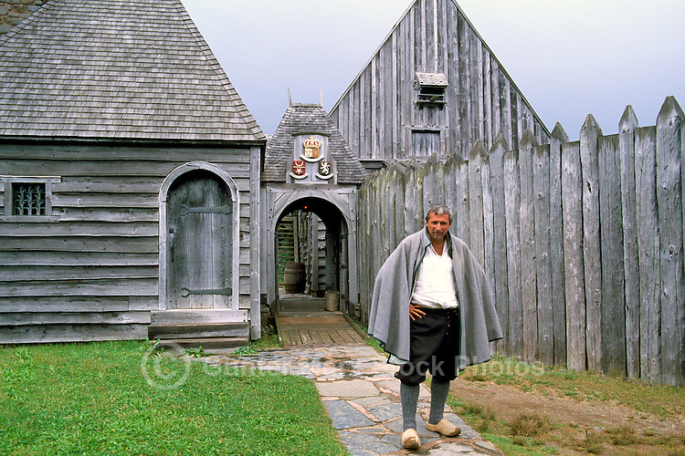 Port-Royal National Historic Site (NHS), Annapolis Royal, NS, Nova Scotia, Canada - Costumed Interpreter standing at Gatehouse of Reconstructed 17th Century French Habitation - Fundy Shore & Annapolis Valley Region