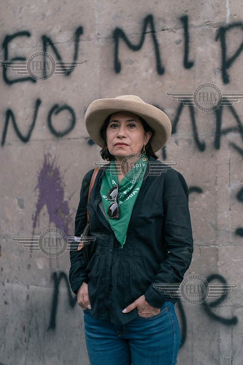 Maria Garcia (63) in Zocalo Plaza during a protest on International Women's Day. ''I think that being a woman in Mexico changes according to age, when you are single you are afraid of harassment, rape, touching, but when you are a mother you are afraid that something will happen to your daughters. But you always live in fear.''
