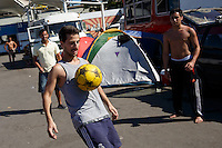 Argentina fans play football at the make-shift camp site for World Cup fans near Praca Onze in Rio de Janeiro