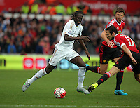 Pictured: Eder of Swansea (L) gets a ball past Daley Blind of Manchester United (R) Sunday 30 August 2015<br /> Re: Premier League, Swansea v Manchester United at the Liberty Stadium, Swansea, UK