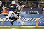 Boise State's Jay Ajayi (27) dives into the end zone against Nevada's Bryan Lane Jr. (25) during the second half of an NCAA college football game in Reno, Nev, on Saturday, Oct. 4, 2014. (AP Photo/Cathleen Allison)