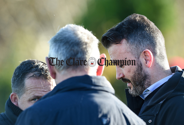 Clare hurling management's new recruit Donal Og Cusack with manager Davy Fitzgerald and selector Mike Browne chatting at half time during the Clare Champion Cup final in Shannon. Photograph by John Kelly.