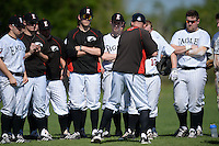 Edgewood Eagles head coach Al Brisack talks with his team after the first game of a doubleheader against the UW-Stout Blue Devils on March 16, 2015 at Lee County Player Development Complex in Fort Myers, Florida.  UW-Stout defeated Edgewood 6-1.  (Mike Janes/Four Seam Images)