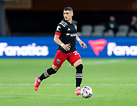 WASHINGTON, DC - APRIL 17: Joseph Mora #28 of D.C. United dribbles during a game between New York City FC and D.C. United at Audi Field on April 17, 2021 in Washington, DC.