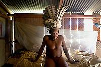 Nangue Yeti, a 70 year old Waorani (Huaroni) man, wearing an eagle's feather head dress. The bird was hunted a few weeks earlier.