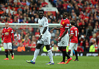 Pictured L-R: Bafetimbi Gomis of Swansea and Tyler Blackett of Manchester United.  Saturday 16 August 2014<br /> Re: Premier League Manchester United v Swansea City FC at the Old Trafford, Manchester, UK.