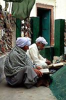 Men are praying at a Sufi-Shrine near Chenepir in the desert of Cholistan.<br /> The people came from far away for praying at the shrine.<br /> 16.2.2001, Chenepir/Punjab<br /> Copyright: Christian-Ditsch.de<br /> [Inhaltsveraendernde Manipulation des Fotos nur nach ausdruecklicher Genehmigung des Fotografen. Vereinbarungen ueber Abtretung von Persoenlichkeitsrechten/Model Release der abgebildeten Person/Personen liegen nicht vor. NO MODEL RELEASE! Nur fuer Redaktionelle Zwecke. Don't publish without copyright Christian-Ditsch.de, Veroeffentlichung nur mit Fotografennennung, sowie gegen Honorar, MwSt. und Beleg. Konto: I N G - D i B a, IBAN DE58500105175400192269, BIC INGDDEFFXXX, Kontakt: post@christian-ditsch.de<br /> Bei der Bearbeitung der Dateiinformationen darf die Urheberkennzeichnung in den EXIF- und  IPTC-Daten nicht entfernt werden, diese sind in digitalen Medien nach §95c UrhG rechtlich geschuetzt. Der Urhebervermerk wird gemaess §13 UrhG verlangt.]