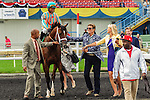 Conquest Typhoon(5) with Jockey Patrick Husbands aboardmakes his way to the winners circle at the Summer Stakes at Woodbine Race Course in Toronto, Canada on September 13, 2014.