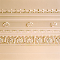 A detail of an ornate neo-classical ceiling highlighting the elaborate plaster frieze