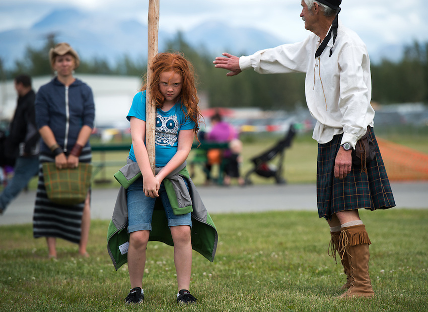 Alexis Emory, 10, gets psyched up to toss the caber during children's field events at the 2015 Alaska Scottish Highland Games at the Palmer fairgrounds.