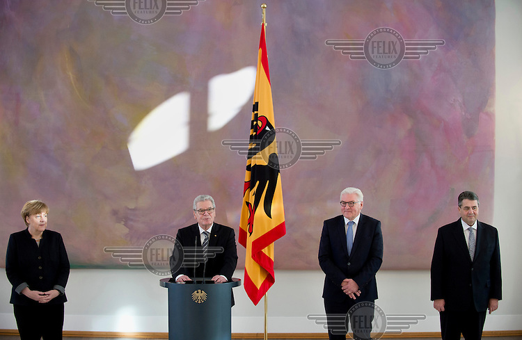 Chancellor Angela Merkel, President Joachim Gauck, Frank-Walter Steinmeier, future president and the former foreign minister and the new foreign Minister Sigmar Gabriel at a ceremony at Schloss Bellevue palace.