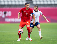 KASHIMA, JAPAN - AUGUST 2: Christine Sinclair #12 of Canada controls the ball during a game between Canada and USWNT at Kashima Soccer Stadium on August 2, 2021 in Kashima, Japan.