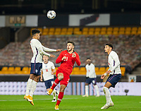 13th October 2020; Molineux Stadium, Wolverhampton, West Midlands, England; UEFA Under 21 European Championship Qualifiers, Group Three, England Under 21 versus Turkey Under 21; James Justin of England wins the header above Halil Dervisoglu of Turkey to clear the England goal