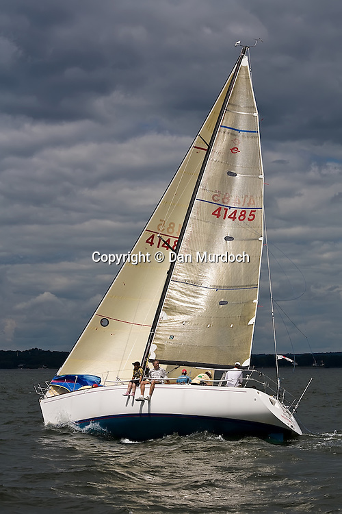 sailboat racing with crew siting on rail