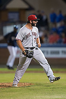 Hickory Crawdads relief pitcher Joe Filomeno (31) reacts after striking out Wes Rogers (not pictured) to end the 6th inning during Game Three of the South Atlantic League Championship at McCormick Field on September 17, 2015 in Asheville, North Carolina.  The Crawdads defeated the Tourists 5-1 to win the 2015 South Atlantic League Championship.  (Brian Westerholt/Four Seam Images)