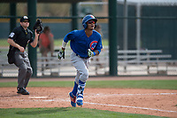 Chicago Cubs second baseman Yeiler Peguero (15) jogs down the first base line during a Minor League Spring Training game against the Oakland Athletics at Sloan Park on March 13, 2018 in Mesa, Arizona. (Zachary Lucy/Four Seam Images)