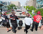 Indycar Crews survey the damage from a wreck during the morning training session at the Baltimore Grand Prix in Baltimore, Maryland on September 4, 2011