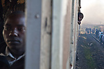 A school boy watches commuters file off the train from Athi River to Nairobi.