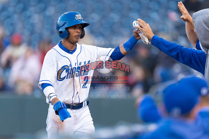 Omaha Storm Chasers third baseman Jecksson Flores (2) is congratulated by teammates after scoring a run during a Pacific Coast League game against the Memphis Redbirds on April 26, 2019 at Werner Park in Omaha, Nebraska. Memphis defeated Omaha 7-3. (Zachary Lucy/Four Seam Images)