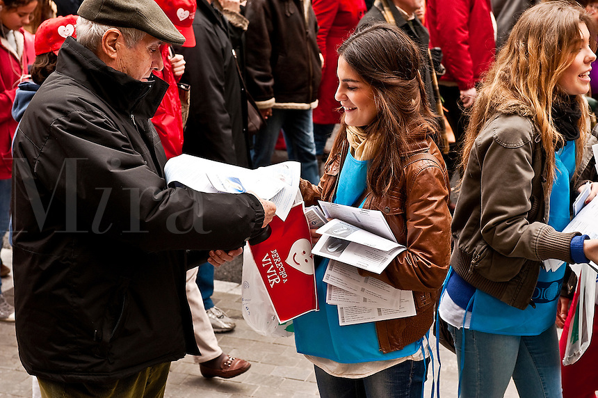 "Young pro-life women hand out leaflets at a huge ""March for Life"" demonstration, March 7th, Madrid, Spain"