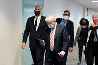 United States Senator Cory Booker (Democrat of New Jersey), left, and United States Senator Lindsey Graham (Republican of South Carolina), second from left, and other Senators evacuate to a safe place in the Dirksen Senate Office Building after Electoral votes being counted during a joint session of the United States Congress to certify the results of the 2020 presidential election in the US House of Representatives Chamber in the US Capitol in Washington, DC on Wednesday, January 6, 2021, as interrupted as thousands of pr-Trump protestors stormed the U.S. Capitol and the House chambers.  .<br /> CAP/MPI/RS<br /> ©RS/MPI/Capital Pictures