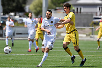 Justin Gulley of Team Wellington competes for the ball with Riley Bidois of the Wellington Phoenix during the ISPS Handa Men's Premiership - Wellington Phoenix v Team Wellington at Fraser Park, Wellington on Saturday 14 November 2020.<br /> Copyright photo: Masanori Udagawa /  www.photosport.nz