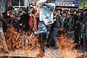 Turquie 2005   Célébration de Nowruz à Dogubayazit, un jeune homme saute au dessus du feu allumé dans la rue<br /> Turkey 2005 Nowruz in the street of Dogubayazit, a young boy jumping over the fire