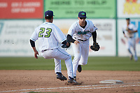 Will Bartlett (44) of the Lynchburg Hillcats takes the ball himself to first base as relief pitcher Randy Labaut (23) hustles to cover the bag during the game against the Myrtle Beach Pelicans at Bank of the James Stadium on May 23, 2021 in Lynchburg, Virginia. (Brian Westerholt/Four Seam Images)