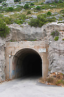 The hand dug road tunnel between Potomje and the Dingac village on the coast. Potomje village, Dingac wine region, Peljesac peninsula. Dingac village and region. Peljesac peninsula. Dalmatian Coast, Croatia, Europe.