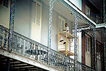 The Spanish-style architecture of the French Quarter in New Orleans, Louisiana dates back hundreds of years to the 1700s.  It is distinctive for the intricate, wrought iron balconies, central courtyards, and quaint doors and windows.