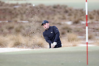 PINEHURST, NC - MARCH 02: Alex Fitzpatrick of Wake Forest University chips out of a bunker and onto the green on the third hole at Pinehurst No. 2 on March 02, 2021 in Pinehurst, North Carolina.