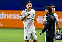 CARSON, CA - OCTOBER 18: Sacha Kljestan #16 and Manager Guillermo Barros Schelotto of the Los Angeles Galaxy have a few words with one another during a game between Vancouver Whitecaps and Los Angeles Galaxy at Dignity Heath Sports Park on October 18, 2020 in Carson, California.