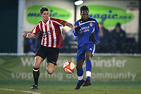 Orlando Smith of Aveley and Frankie Curley of Hornchurch - AFC Hornchurch vs Aveley - Ryman League Premier Division Football at The Stadium - 08/03/11 - MANDATORY CREDIT: Gavin Ellis/TGSPHOTO - Self billing applies where appropriate - Tel: 0845 094 6026