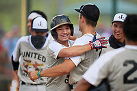 Eddie Saldivar (5) is congratulated by Carson Crawford (7) after hitting a home run while during the WWBA World Championship at Lee County Player Development Complex on October 9, 2020 in Fort Myers, Florida.  Eddie Saldivar, a resident of Clovis, California who attends San Joaquin Memorial High School, is committed to Long Beach State.  (Mike Janes/Four Seam Images)