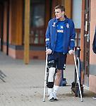Dean Shiels watches training on his crutches