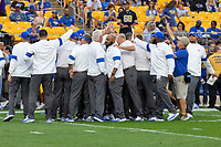 The Pitt football coaches huddle before the game. The Virginia Cavaliers defeated the Pitt Panthers 30-14 in a football game at Heinz Field, Pittsburgh, Pennsylvania on August 31, 2019.