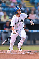 Asheville Tourists first baseman Brian Mundell (15) swings at a pitch during a game against the  Hagerstown Suns at McCormick Field on September 2, 2016 in Asheville, North Carolina. The Suns defeated the Tourists 5-1. (Tony Farlow/Four Seam Images)