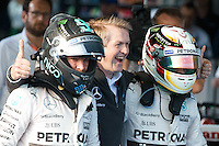 March 15, 2015: Lewis Hamilton (GBR) #44 and Nico Rosberg (DEU) #6 from the Mercedes AMG Petronas F1 Team celebrate their 1st and 2nd place at the 2015 Australian Formula One Grand Prix at Albert Park, Melbourne, Australia. Photo Sydney Low